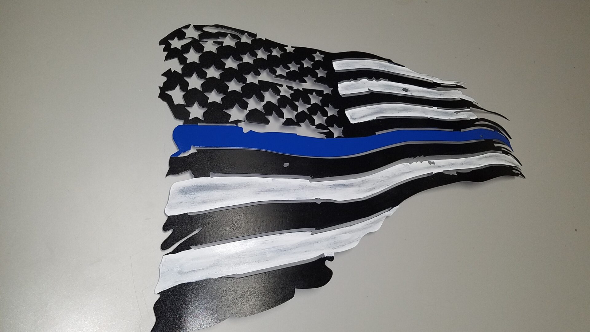 Tattered American Flag with Thin Blue Line Honor Stripe
